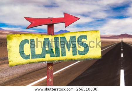 Claims sign with road background - stock photo