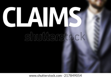 Claims written on a board with a business man on background - stock photo
