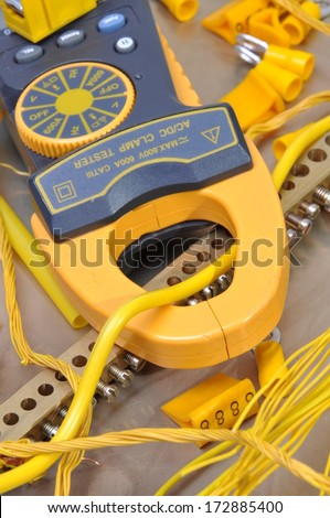 Clamp meter tool for measuring electrical installations - stock photo
