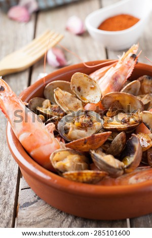 clams and prawns at paprika spanish seafood style - stock photo