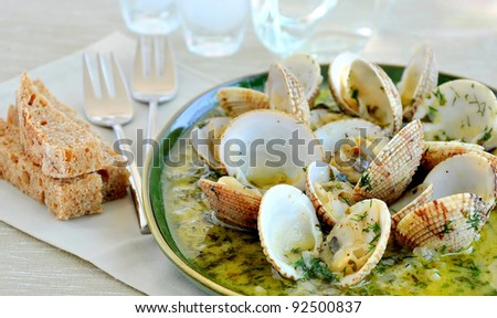 Clams/cockles in white wine sauce - stock photo