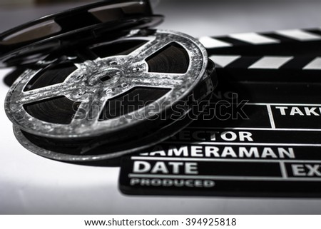 Clap movie on a light background. Metal film coil. Objects for shooting movies and demonstrations - stock photo