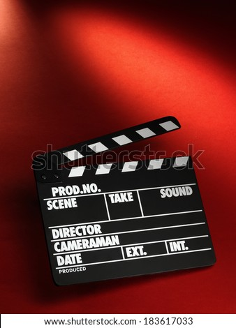 Clapper board on red background