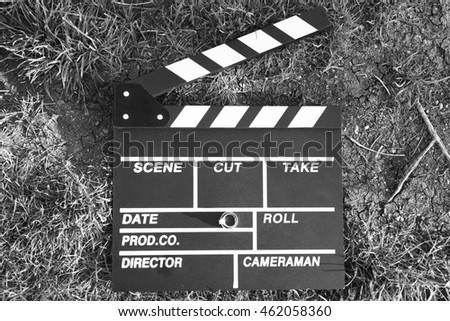 clapper board with an engagement ring, black and white photo
