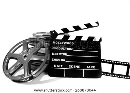 Clapperboard and reels - stock photo