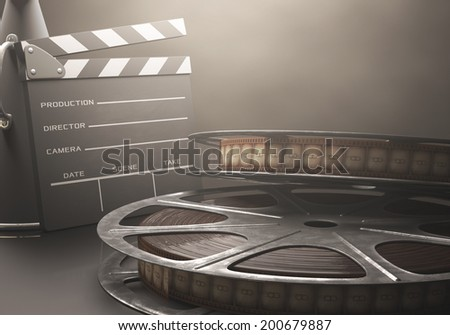 Clapperboard with rolls of film in the retro concept cinema.