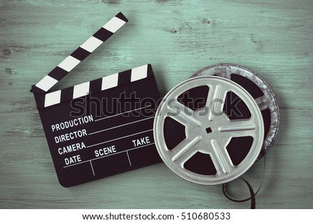 Clapperboards two film reels painted on stock photo royalty free clapperboards and two film reels are painted on the board thecheapjerseys Choice Image