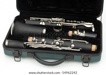 Clarinet broken down in its travel case Isolated on white - stock photo