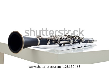 Clarinet on the sheet, music instrument for symphony band - stock photo