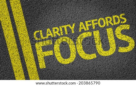Clarity Affords Focus written on the road - stock photo