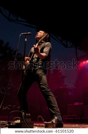CLARK, NJ - SEPTEMBER 11: Lead vocalist and guitarist Damian Kulash of the band OK Go performs at the Union County Music Fest on September 11, 2010 in Clark, NJ. - stock photo