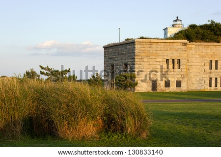 Clark's Point lighthouse is located inside Fort Taber, in New Bedford, Massachusetts. The area became a main defensive military site during the Revolutionary War, the War of 1812, and the Civil War. - stock photo