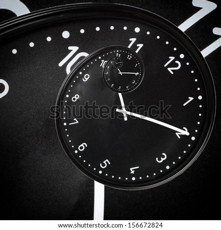 Clasic black clock in the drost effect - stock photo