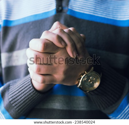 clasped hands - stock photo