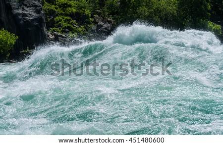 Class six rapids in river by White Water Walk near whirlpool rapids at Niagara Falls - stock photo