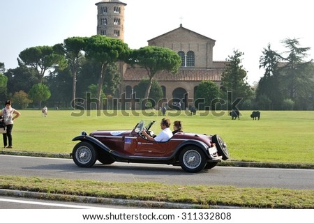 CLASSE (RA), ITALY - SEPTEMBER 21: A red Alfa Romeo 4 R takes part to the GP Nuvolari classic car race on September 21, 2014 in Sant'Apollinare in Classe (RA). The car was built in 1968 - stock photo