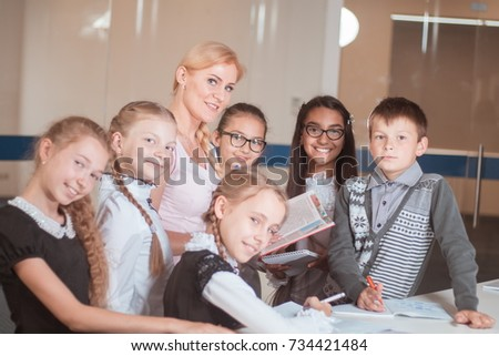 classes in a creative children's school, posing girls, boys and a teacher