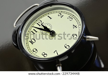 classic alarm clock, on black and gray background, close up /Alarm Clock