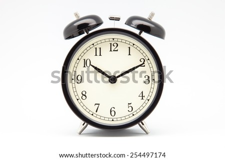 Classic alarm clock with white background