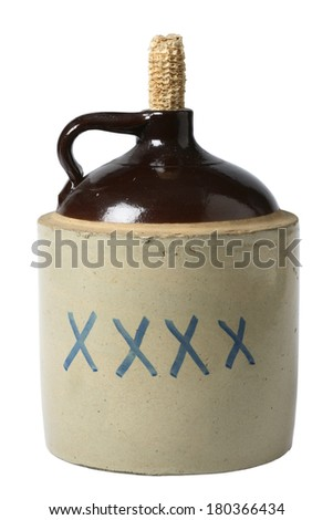 Classic alcohol bottle with corn husk top on white - stock photo