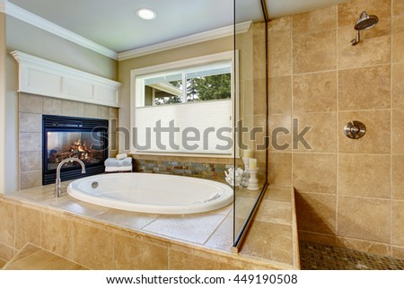 Classic American bathroom with whithe bath tub and shower. Also fireplace - stock photo
