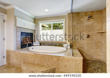 Classic American bathroom with whithe bath tub and shower. Also fireplace