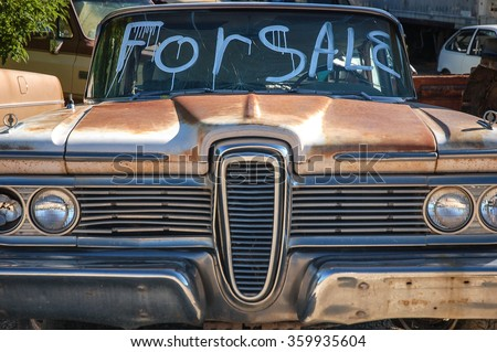 Classic American car (Edsel) for sale displayed in the junkyard. - stock photo