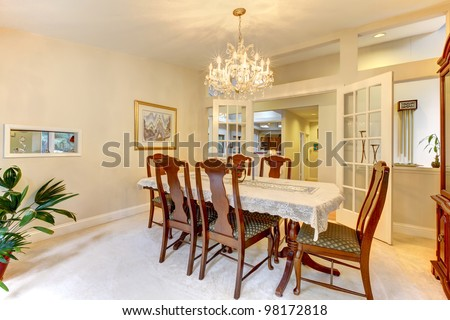 Classic American dining room interior with open french doors.