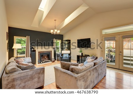 Classic American family room with fireplace and sofas. Has vaulted ceiling with skylight . Northwest, USA