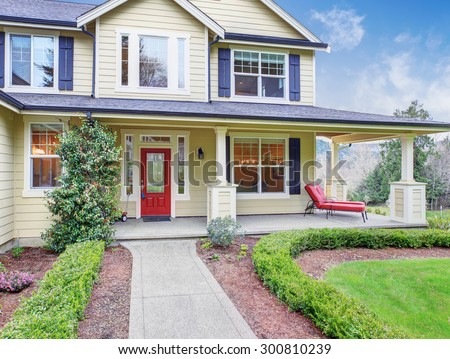 Classic American Home Yellow Exterior Blue Stock Photo