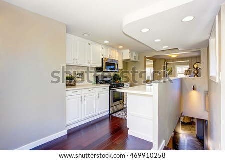Classic American kitchen room interior with white cabinets and hardwood floor. Northwest, USA