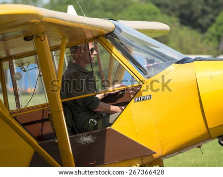 classic american Piper Cub 1930s aircraft at Breighton airfield,Yorkshire,UK.taken 01/06/2014 - stock photo