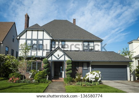 Classic American suburban house with blue sky background - stock photo