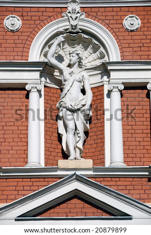 classic ancient statue of woman in front of a building in Odessa - stock photo