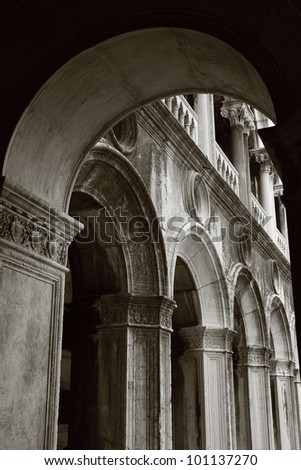 classic arch with part of a wall in Venice - stock photo