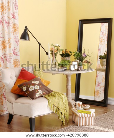 classic armchair coffee table behind yellow wall interior vertical banner - stock photo