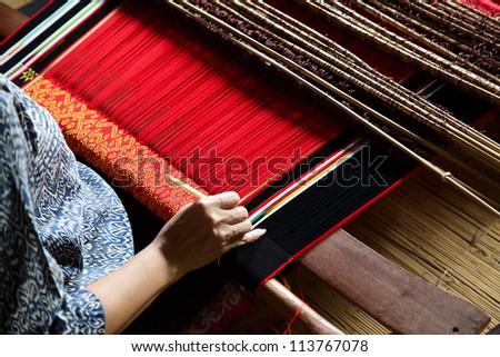 classic asian loom at work - stock photo