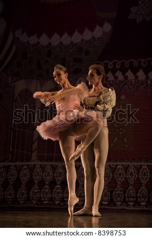 classic ballet male dancer standing by  female dancer on painted background