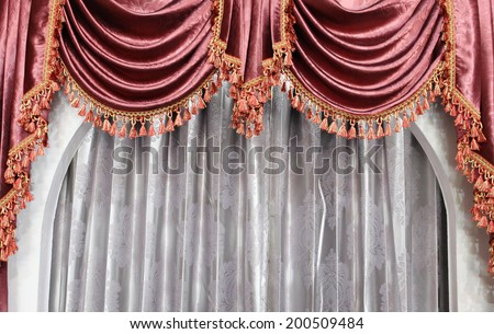 Classic beige curtain hanging on a window in room  - stock photo