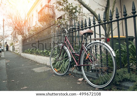 classic bicycle at the town with lens flare.Warm toning effect. Retro and vintage style