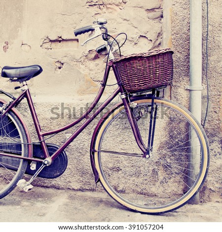 Classic bicycle with basket. Filtered image. - stock photo
