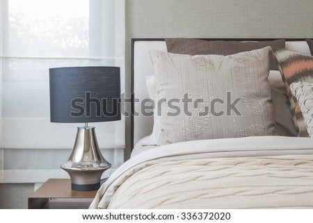 classic black lamp style on wooden table in bedroom