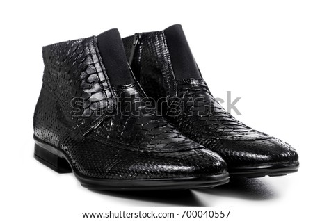 Classic black male shoes made of crocodile leather isolated on white background