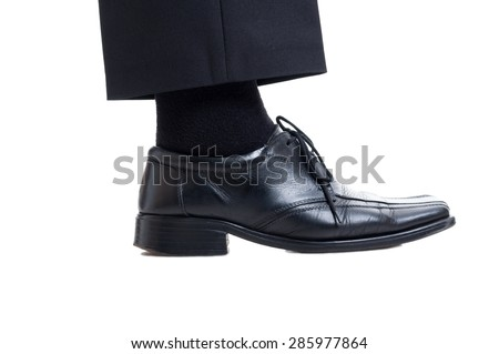 Classic black suit pants, sock and leather shoe isolated on white background. Business manager foot concept - stock photo