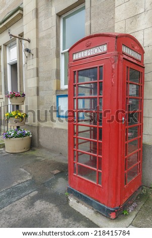 Classic British Red Phone Booth in Coldstream UK - stock photo
