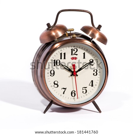 Classic bronze colored vintage style alarm clock with bells and a modern dial with a red second hand on a white background