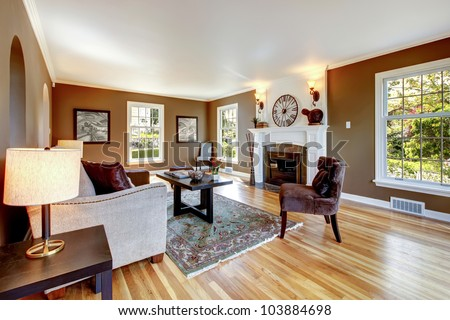 Classic brown and white living room interior with hardwood floor. - stock photo