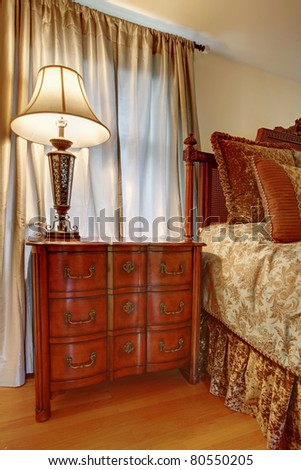 Classic brown nightstand near the bed