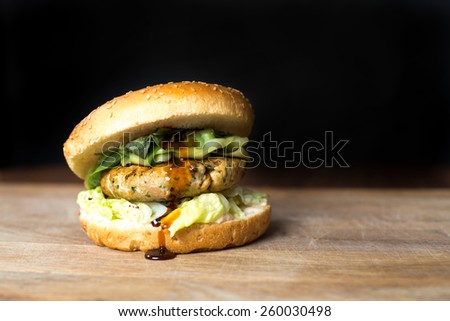 Classic Burger. Tasty and fastfood burger meal on the table - stock photo