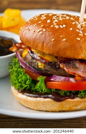 classic burger with cheddar and bacon - stock photo